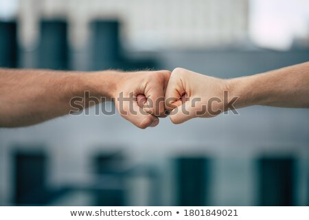 Iki iş eller el sıkışma zincir güç Stok fotoğraf © Paha_L