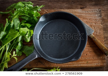 cast iron pan on dark background Stock photo © yelenayemchuk