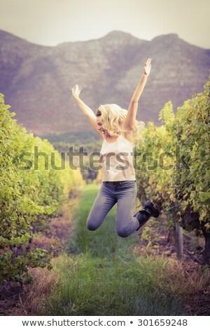 блондинка прыжки виноградник портрет счастливым промышленности Сток-фото © wavebreak_media