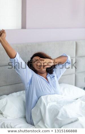 Gyönyörű nő afro frizura felfelé nyújtás karok Stock fotó © dash