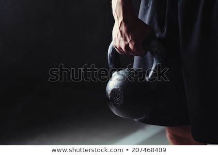 sportsman holding kettlebell  Stock photo © LightFieldStudios