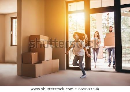 mosolygó · nő · dob · párna · férfi · fiúbarát · költözés - stock fotó © dashapetrenko