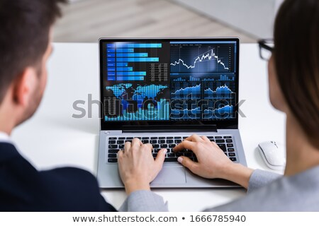 Two Businesspeople Analyzing Graphs Stock photo © AndreyPopov