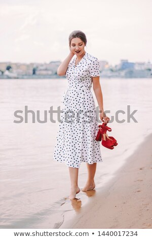 Beautiful brunette in polka-dot dress Stock photo © acidgrey