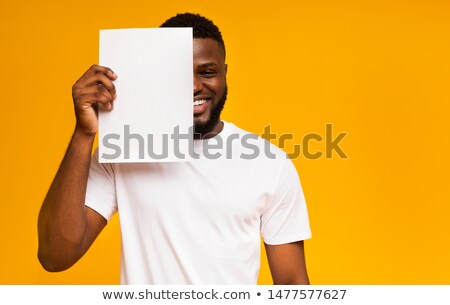 casual man covers his face with a blank board  Stock photo © feedough