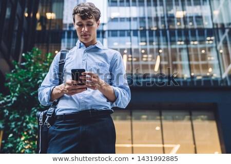 Pénzügyi negyed üzletember telefon többszörös kitettség okostelefon Stock fotó © nito
