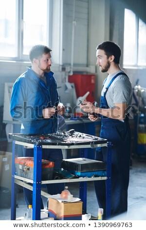 Discussing handtools Stock photo © pressmaster