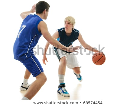 Young professional basketball player defending the ball from attack of rival Stock photo © pressmaster