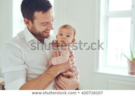 Boldog apa tart kicsi baba lánygyermek Stock fotó © dolgachov