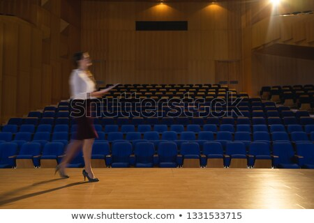Side view of blur beautiful Caucasian businesswoman practicing and learning script while walking in  Stock photo © wavebreak_media