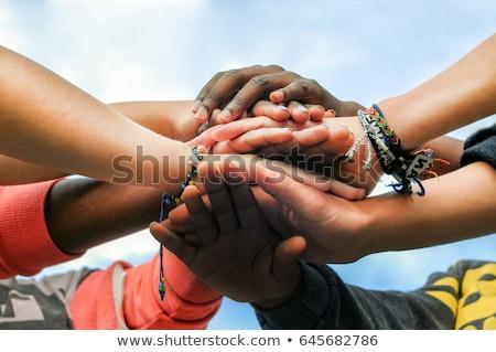 Gruppo giovani amici mani insieme donna Foto d'archivio © HighwayStarz