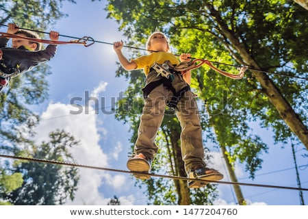 Two little boys in a rope park. Active physical recreation of the child in the fresh air in the park Stock photo © galitskaya
