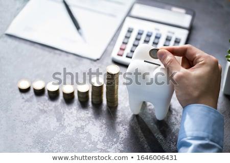 Tandheelkundige implantaat geld tand verzekering kosten Stockfoto © AndreyPopov