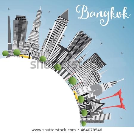 Bangkok Skyline with Gray Landmarks, Blue Sky and Copy Space.  Stock photo © ShustrikS