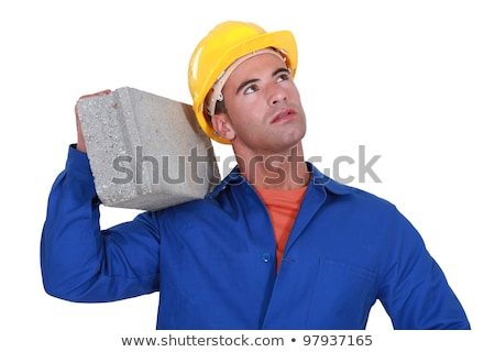 Laborer carrying cinderblock Stock photo © photography33