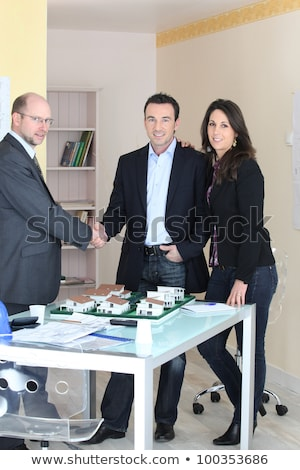 happy couple stood by estate agent stock photo © photography33