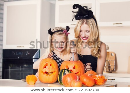 Woman helping her children carve pumpkins Stock photo © photography33