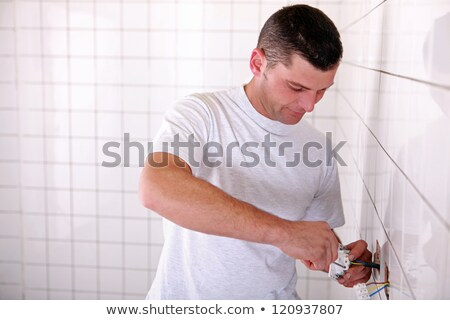 electrician installing outlet in tiled space stock photo © photography33