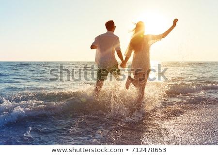 Barátnők fürdik tenger kezek nap szépség Stock fotó © photography33