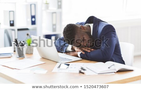 Young businessman sleeping on his desk stock photo © wavebreak_media