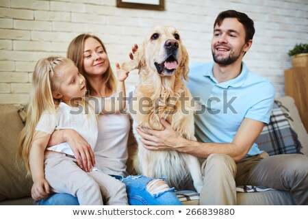 Parents and little girl cuddling dog Stock photo © photography33