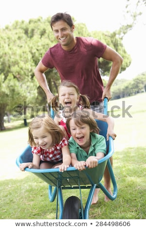 Ragazza ragazzo carriola bambini giardino estate Foto d'archivio © monkey_business