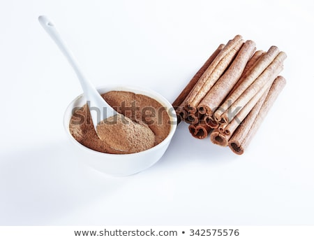 Dried ground spices in ceramic spoons Stock photo © juniart