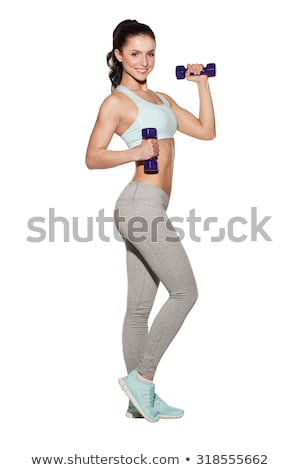 Stock photo: Beautiful slim woman with dumbbells on white