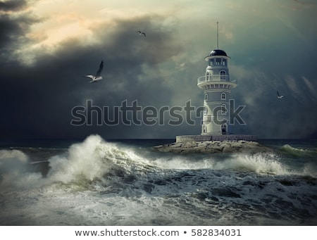Powerful lighthouse illuminated Stock photo © smithore