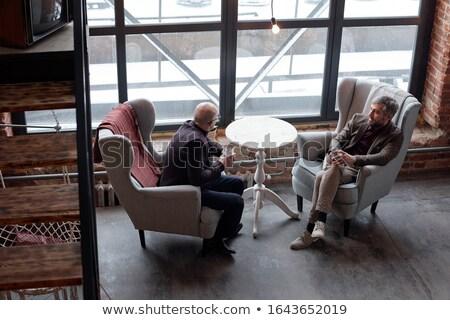 biznesmenów · mówić · bar · biznesmen · spotkanie · hotel - zdjęcia stock © nyul