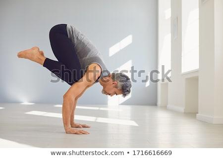 man practicing yoga stock photo © hasloo