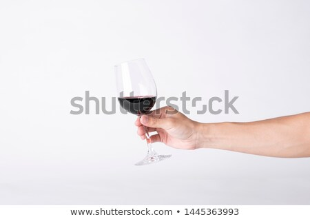 Main verre vin rouge isolé blanche vin Photo stock © tetkoren