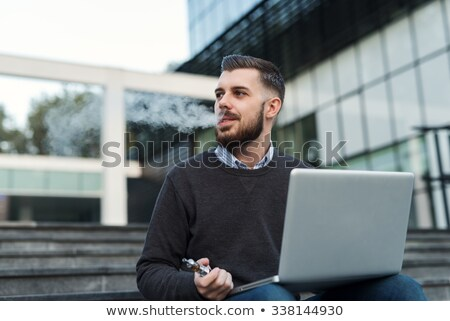 casual businessman with electronic cigarette stock photo © wavebreak_media