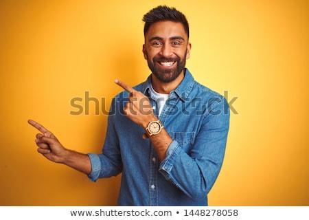 Indian man pointing up Stock photo © szefei