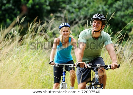 young girl riding bicycle outside healthy lifestyle stock photo © master1305