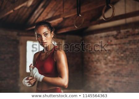 スポーツウーマン ポーズ タオル 笑みを浮かべて カメラ ストックフォト © stokkete
