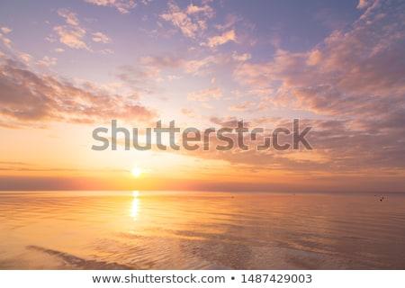 Gün batımı deniz sarı ışık ada tekne Stok fotoğraf © bank215