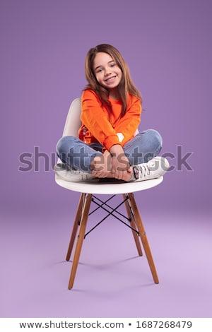 Cute brunette on the chair Stock photo © konradbak