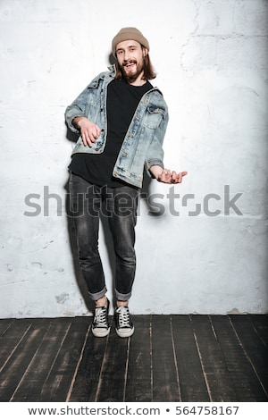 Man dressed in shirt in a cage playing on guitar Stock photo © deandrobot