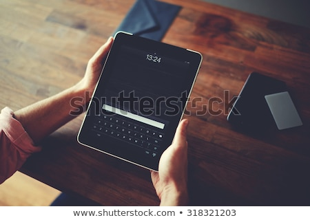 Businessperson's Hand Holding Digital Tablet stock photo © AndreyPopov