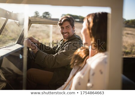 Young couple interacting while travelling in vehicle Stock photo © wavebreak_media