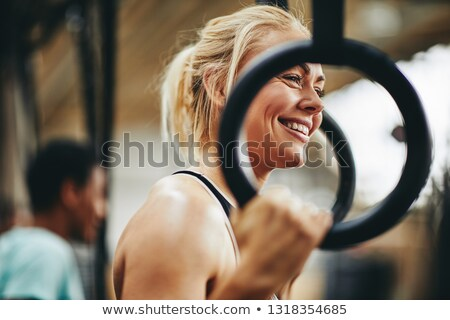 portrait of smiling athlete with rope standing in gym stock photo © wavebreak_media