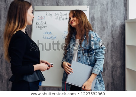 Two girls by whiteboard Stock photo © IS2