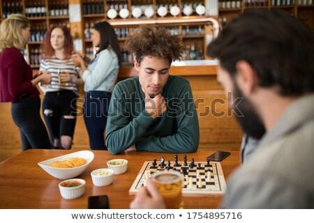 Két férfi játszik sakk üveg sör bár Stock fotó © wavebreak_media