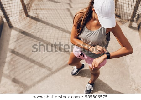 Woman runner looking at watch Stock photo © IS2