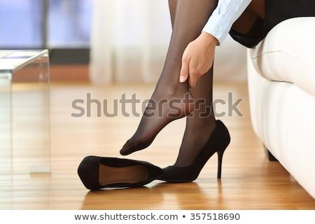 Barefooted woman in stockings Stock photo © Pilgrimego