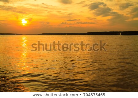 Sunrise over the river with yachts on a calm water surface Stock photo © artsvitlyna