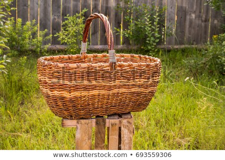 big old weathered empty wicker laundry basket stock photo © valeriy