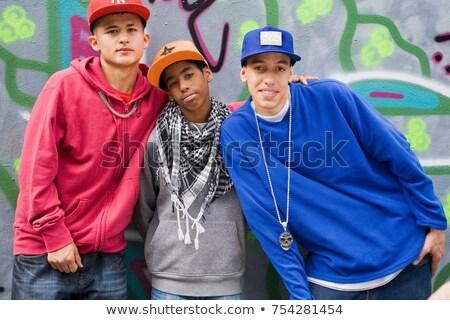 Hispanic Teenager against graffiti wall Stock photo © IS2
