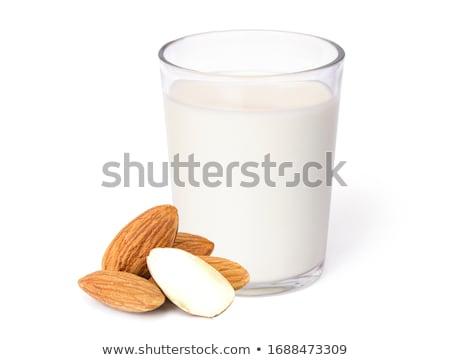 Közelkép üveg mandula tej frissítő étel Stock fotó © mpessaris